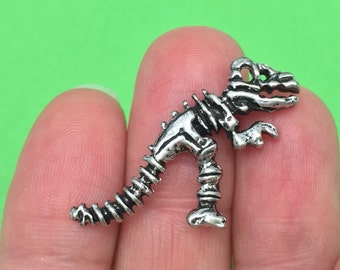 4 Dinosaur charms (double-sided) Ref SC489