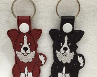 Vinyl Border Collie Keyrings - Red and white, or black and white