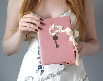 Pink leather hardcover notebook with a metallic key