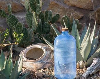 Streaked blue glass bottle