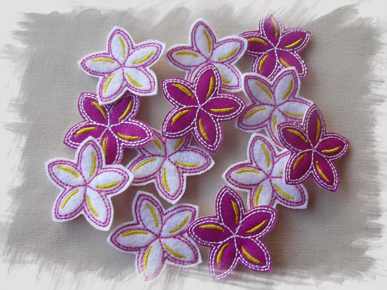 Frangipani felties with felt or glitter vinyl in the