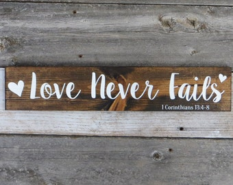 """Rustic Hand Painted """"Love Never Fails"""" Wood Sign"""