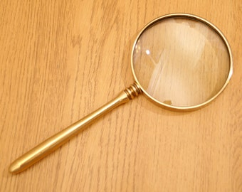 Magnifying Glass in a brass frame