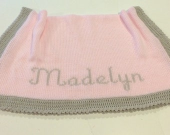 Handmade knitted baby pink blanket with baby gray picot edging. Monogramming free for baby's first name..
