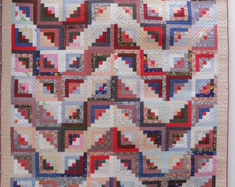 "Log cabin quilt.  Queen size quilt.  Scrap quilt.  Hand quilted.   90""x104"" finished.  Blue backing."