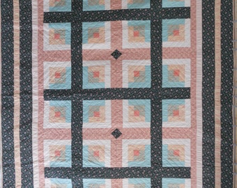 """King size quilt. Log cabin quilt.  Green and peach.  Hand quilted.  100% cotton. Finished size 100"""" x 114"""".  Queen or king size bed."""