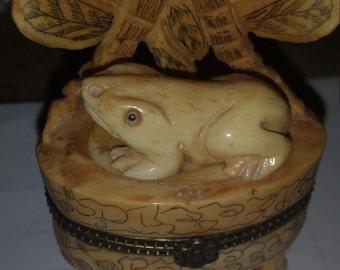 antique frog netsuke on scrimshaw