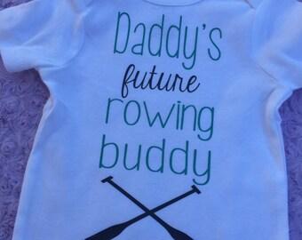 Daddy's future rowing buddy. Rowing. Kyaking. Oars.