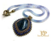 Royal blue & gold bead embroidery pendant with natural sodalite cabochon