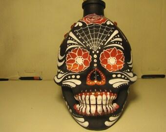 Hand painted glass skull bottle