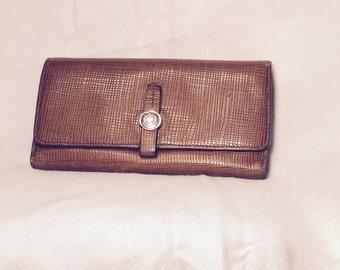 Vintage Tumi Embossed Leather Wallet