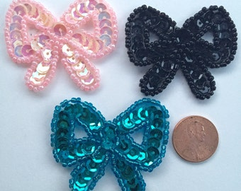 Darling lottle Sequin bow appliques in baby pink, black or turquoise