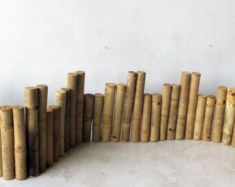 "Uneven Top 1.5"" Diameter Solid Bamboo Edging 12"" H x 10"" H x 8""H x 60""L"