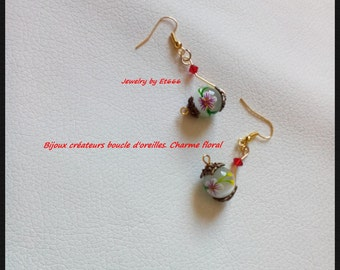 Jewelry designer earrings. floral charm