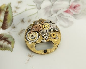 steampunk brooch with old gears , smile, smiling face, face, vintage style, unique piece