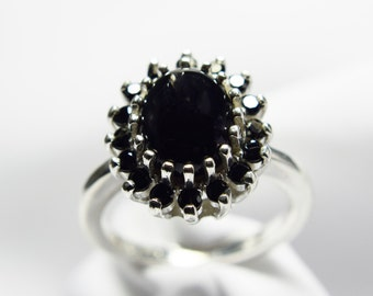 Black Onyx 10mm by 8mm Oval With Black Spinel Halo set in.925 Sterling Silver Ring