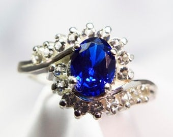 Blue Spinel By-pass Ring With White Topaz Down the Shoulders