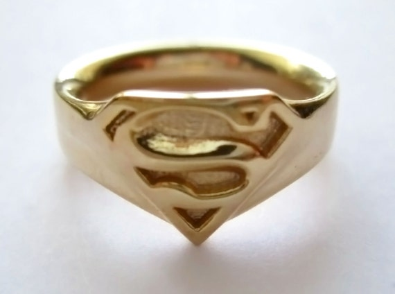 gold plated superman supergirl ring by jeremymallin on etsy