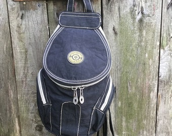Vintage Backpack/ 90s / Black/ three pockets/ Adjustable straps/ lined/ Nylon/ height 24 cm/ Made in Italy