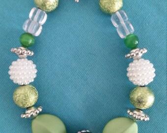 Handmade green and white beaded bracelet