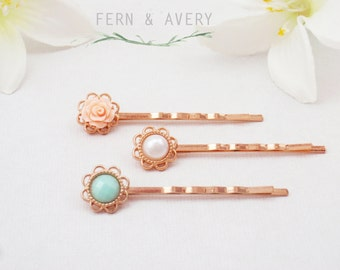 Rose gold flower hair pins. Pale turquoise green, peach, and creamy white. Rose gold hair clips