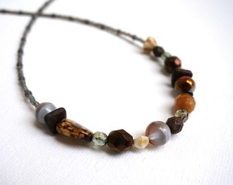 unique necklace with neutral colored czech glass beads. Original, eclectic, asymmetric, beaded boho necklace.