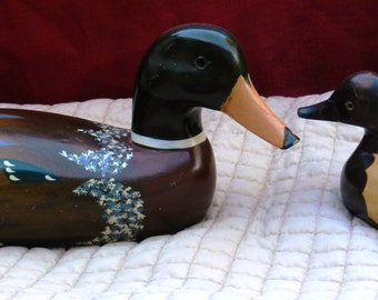 A Mismatched Pair of Painted Wooden Ducks               00559