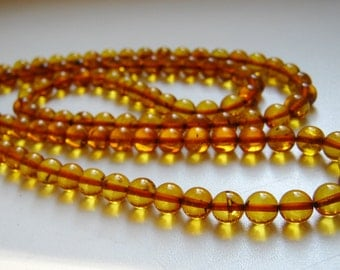 Warmth - 108 baltic amber mala for meditation for meditation (size Ø7 colour 4), buddhist meditation, guru bead, 108 bead mala