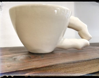 Cup of cappuccino or tea with fingers