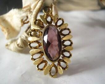 Vintage pendant with purple glass cabochon