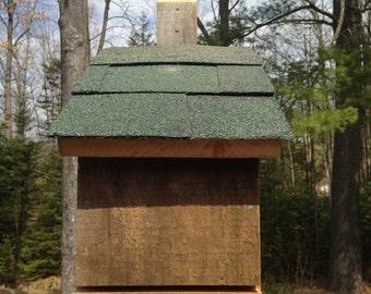 Wooden bat house