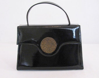 Like New Vintage 1960s Risque Handbag / Purse in Black Faux Patent Leather with Brass Floral Medallion