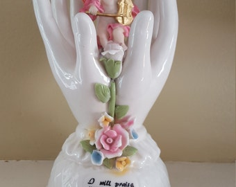 Ceramic hands holding angel...highly detailed....violin...sculpted roses....glazed
