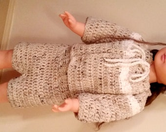 Crocheted baby hat/sweater/shorts/booties