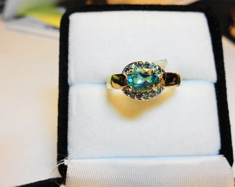 Apatite Ring.  In a 14kt. Gold Ring a Natural Apatite Oval with Blue Diamond Accents .