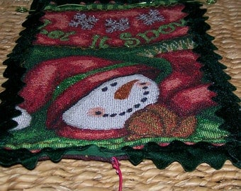 Christmas or winter wall or door hangings featuring Santa or a Snowman