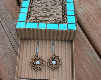 Cardboard earrings in the box