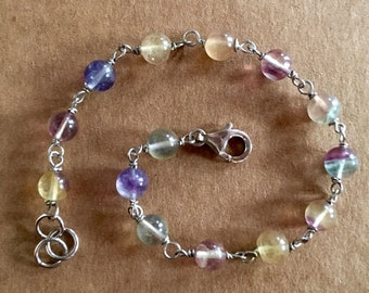 Rosary style bracelet with multicolored glass stones