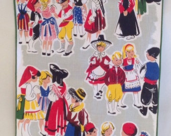 Vintage European fabric of children in European national costumes wall hanging.