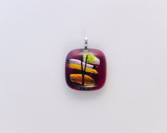Red fused glass pendent, with accented dichroic glass