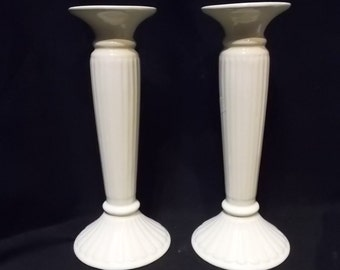 Set of two candelabras (candleholders) made of white ceramics.