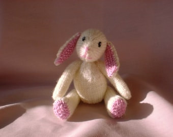 Pdf Knitting Pattern for a sweet little baby bunny rabbit toy with pink ears by Angela Turner