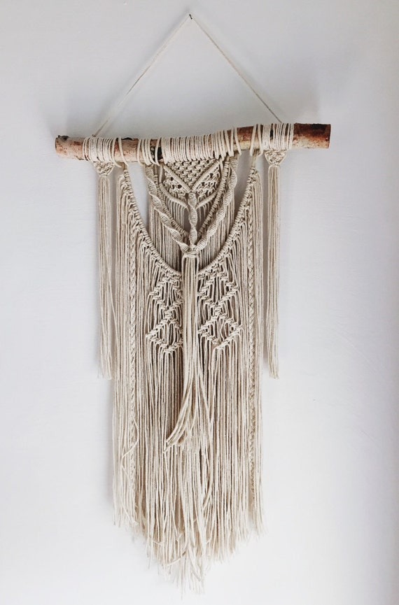 macrame wall hanging on birch wood textured fringe wall