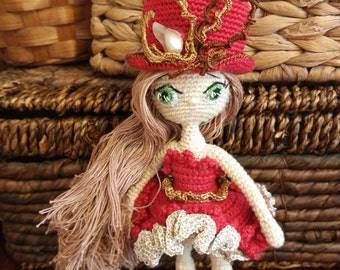 Doll. Toy handmade. Amigurumi. Doll with flowers. Knitted toy. Toy for decoration. Gift for children.Doll in a hat.