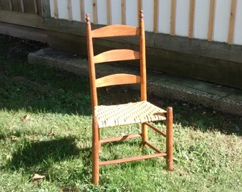 very petite little ladder back chair