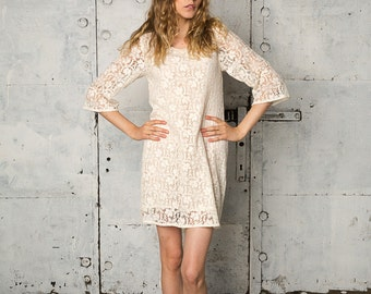 Loose fitting white bohemian lace dress with three-quarter sleeves, Tory