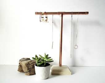 Unavailable listing on etsy for Copper pipe jewelry stand