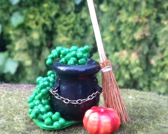 Miniature witch's cauldron Halloween decoration with broom and pumpkin dollhouse accessory