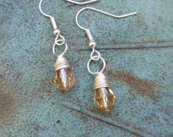 Sterling silver wrapped golden glass beads