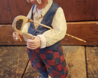 Old-fashioned golfer carving